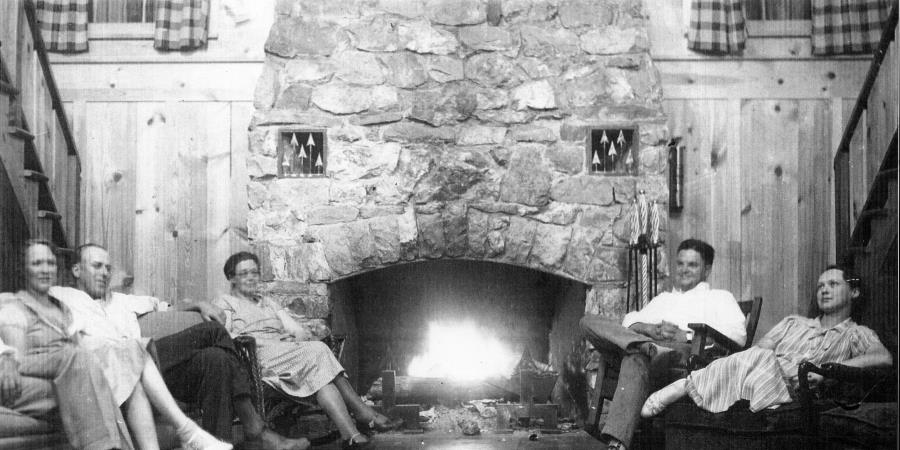Alice McNett, Ross McNett, Nona Biles, John Maley & Julia Maley around the Lodge fireplace.jpg