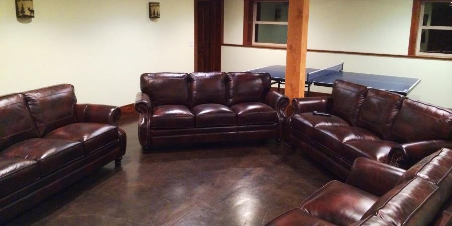 Heated floors and rich leather couches at the Lodge at Palmer Lake