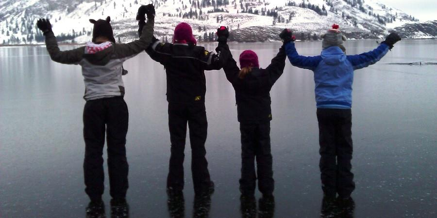 Kids playing on the frozen lake at the Lodge at Palmer Lake