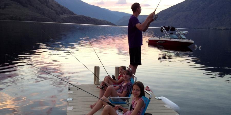 Kids fishing from the dock at the Lodge at Palmer Lake