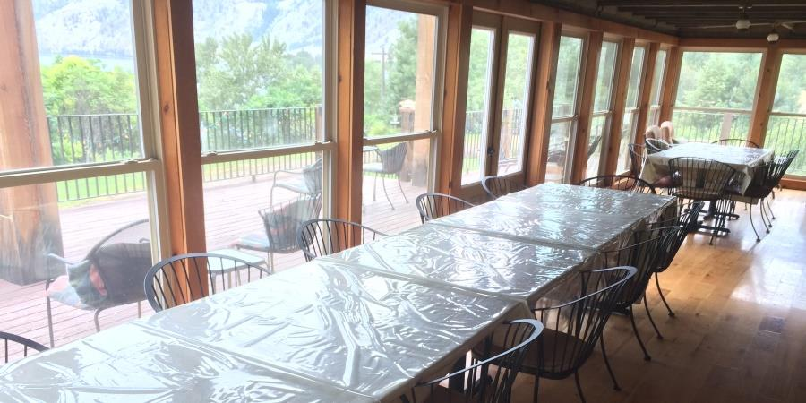 Extensive dining area for large groups on the porch at the Lodge at Palmer Lake